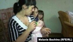 Ольга Денисенко с новорожденной