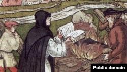 Мартін Лютер спалює папську буллу, гравюра на дереві, 1557 рік