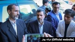 A recent photo showing Iranian former president Mahmoud Ahmadinejad with his aides.