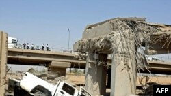 A damaged bridge following a massive explosion near the Finance Ministry in Baghdad on August 19.