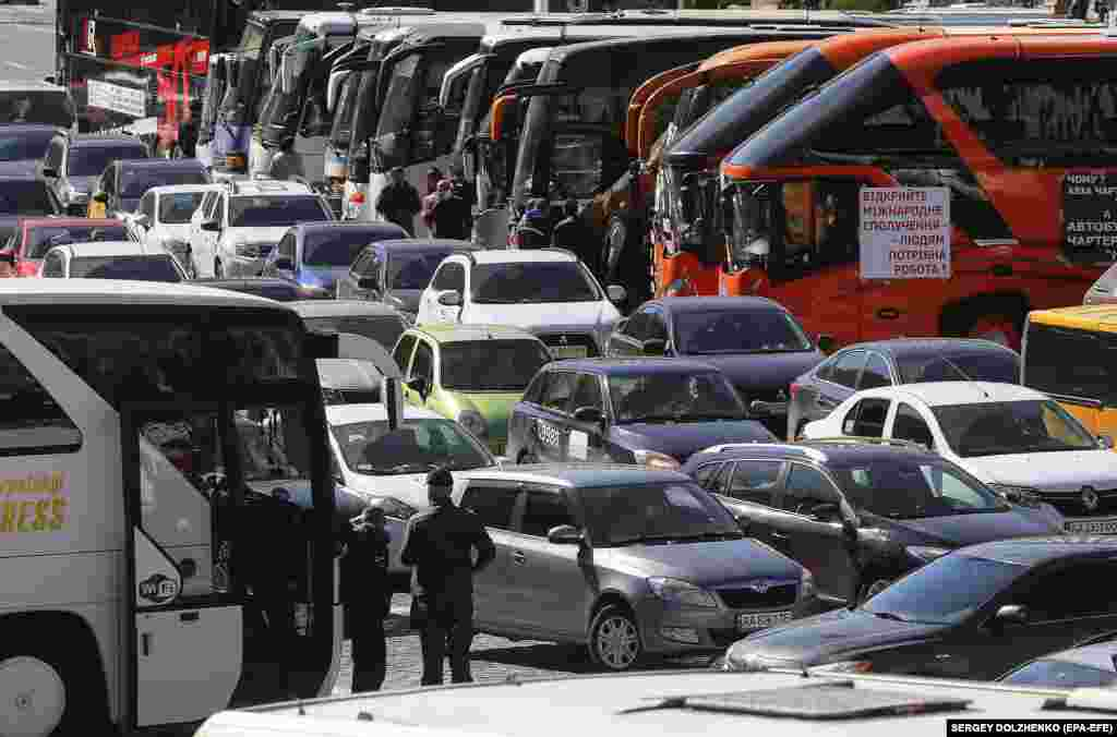 Buses and cars parked by Ukrainian small business owners during a protest in Kyiv on May 13 who were demanding they be allowed to return to work.