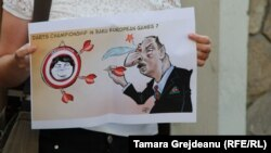 Chisinau: A demonstrator holds a poster during a protest at the Azerbaijani Embassy against the verdict in the case of Khadija Ismayilova.3Sep2015