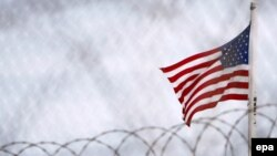 The U.S. flag flies over the detention facilities at Guantanamo Bay.