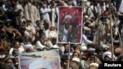 Supporters of the Pakistani religious party Jamiat-e Ulema-e Islam hold pictures of Al-Qaeda leader Osama bin Laden during an anti-U.S. rally on the outskirts of Quetta on May 6.