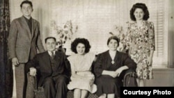 Armenia -- Titanic survivor Neshan Krekorian (seated) with younger daughter seated in middle, wife, Persape (seated right), son standing, and older daughter standing.