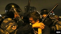 Russian police detain protesters in Moscow in October 2013. After years of squashing rights activists, is the Kremlin changing tactics?