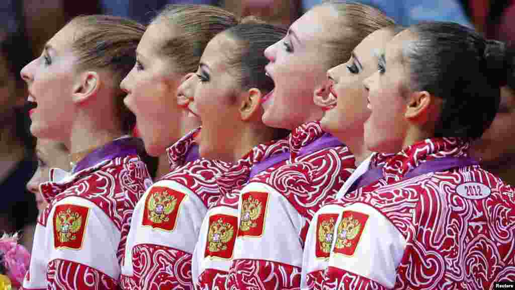 Team Russia sing their national anthem as they celebrate with their gold medals in the victory ceremony after the group all-around rhythmic gymnastics final at the London Games. (Reuters/Mike Blake)