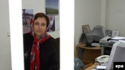 "Shirin Ebadi, shown in her Tehran office in July, says her rights activities ""have never depended on one office or a building."""