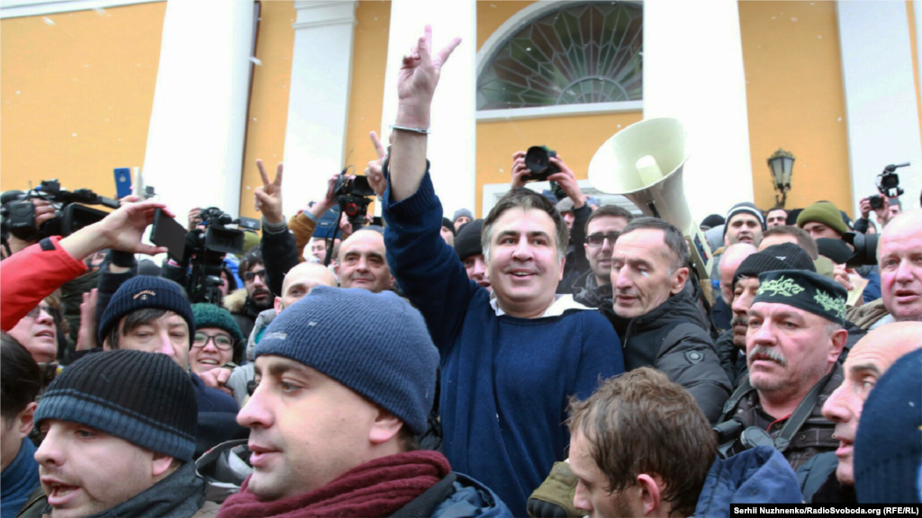 Saakashvili surrounded by his supporters after being freed from police detention