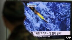 Телевидение Южной Кореи передало кадры комьютерного моделирования запуска ракеты. 13 апреля 2012 г.