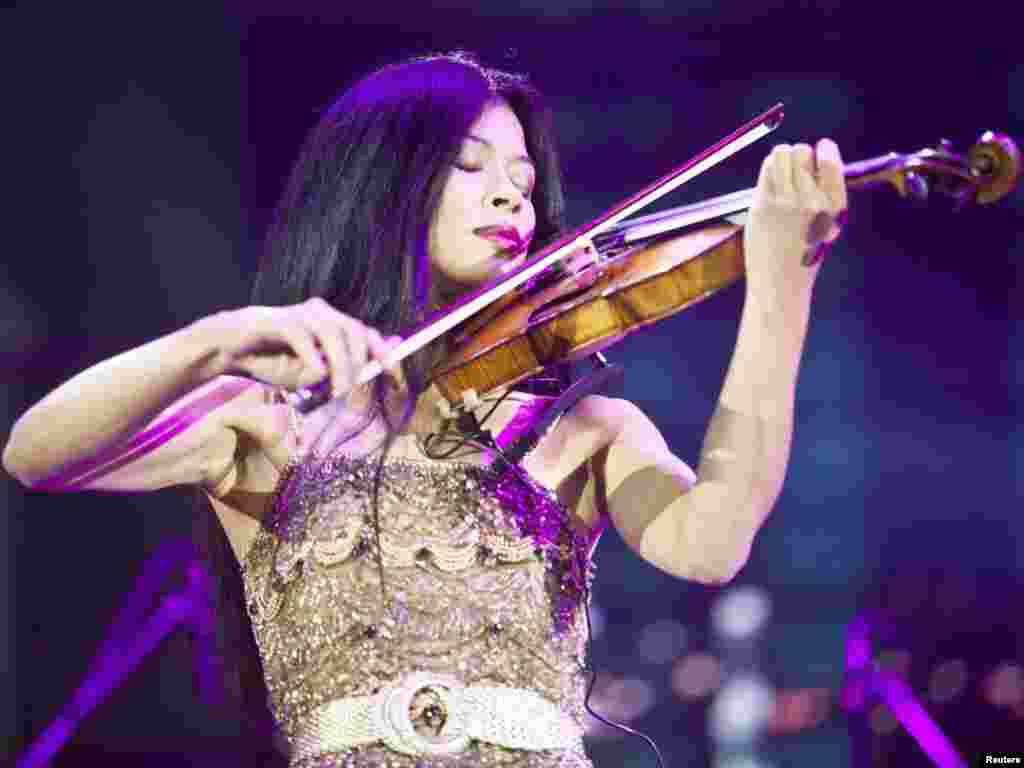 British musician Vanessa-Mae performs during a ceremony to mark the 35th birthday of Ramzan Kadyrov in the Chechen capital, Grozny, in 2011. She acknowledged receiving money for her appearance.