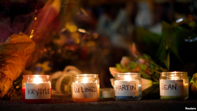Candles at a memorial on Boston's Boylston Street on April 21 dedicated to those who died in the Boston Marathon bombings on April 15 and the MIT campus police officer killed four days later.