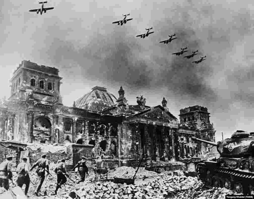 The battered Reichstag photographed in 1945. Some of Khaldei's photographs were heavily doctored, and many were staged for propaganda purposes. But between the montages and propaganda, Khaldei's archive holds exceptional examples of photojournalism.