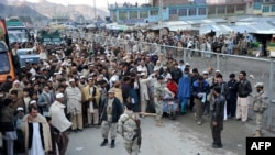 Afghan residents wait at the main border crossing Torkham, between Afghanistan and Pakistan in Nangarhar Province.