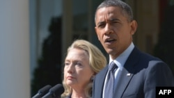 Hillary Clinton, then-U.S. secretary of state, in the Rose Garden of the White House with U.S. President Barack Obama in 2012