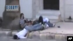 Amateur video released by the Shams News Network shows dead and injured bodies on the street in Homs on August 10.