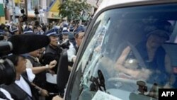 Japanese police with their hands full in Sapporo on July 5