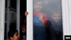 A group of migrant children from Iraq and Afganistan at a center for migrants in eastern Serbia