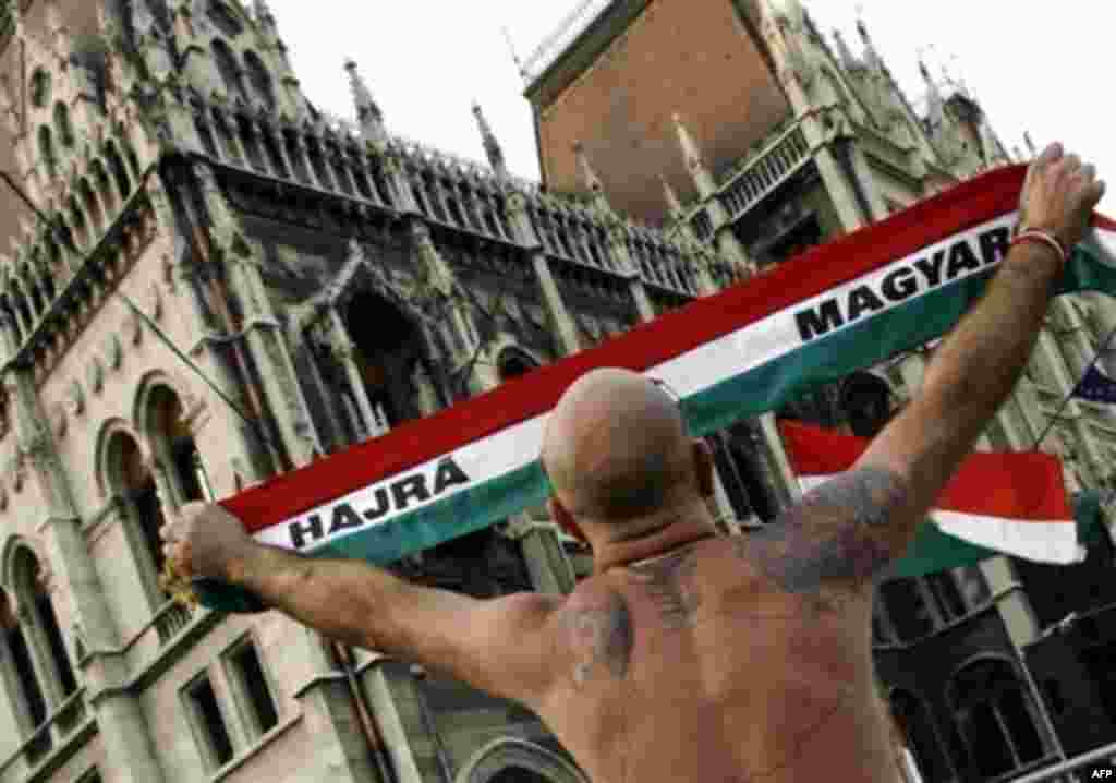 A protester outside the Hungarian parliament makes clear his nationalist credentials with a tattooed map of Hungary on his back (AFP) - The dominant image of violence in Europe in 2006 came in Hungary in September. The spark was the prime minister's admission that he lied about the state of the economy to win elections in the summer. The violence -- which left hundreds injured and brought a huge police presence to the capital -- was the worst in Budapest since 1956.