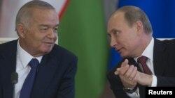 Өзбекстан президенті Ислам Каримов (сол жақта) Ресей президенті Владимир Путин (оң жақта). Ресей, Мәскеу, 15 сәуір 2013 жыл.