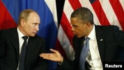 Рускиот и американскиот претседател Владимир Путин и Барак Обама