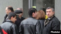 People line up outside an exchange office in Armenia earlier this month.