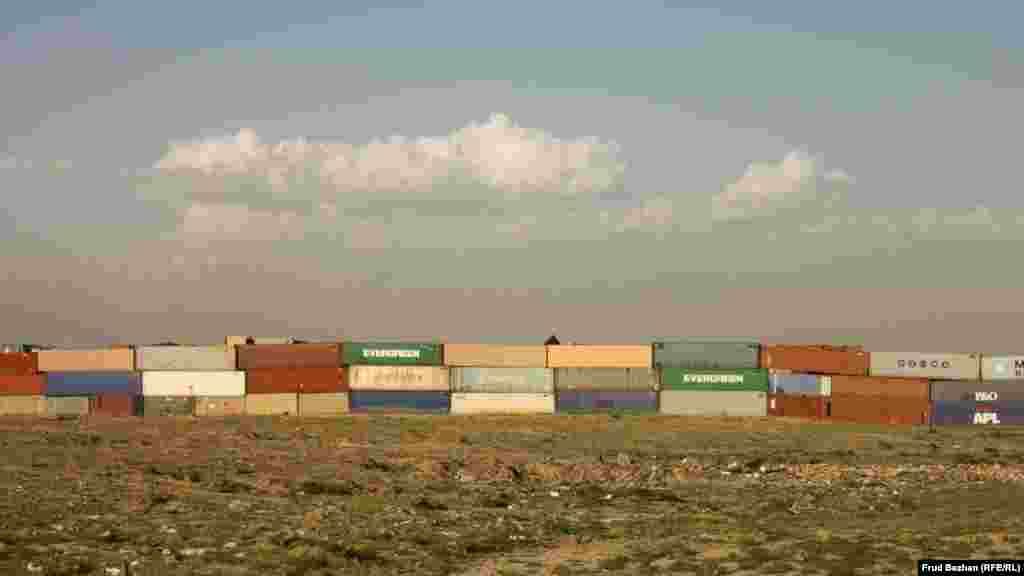 A huge row of shipping containers outside Bagram Airfield.