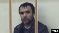 Abdukayum Makhmudov, suspected of recruiting for Hizb ut-Tahrir and spreading radical Islam, attends a court hearing in Moscow on October 20.