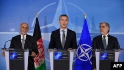 Afghan President Ashraf Ghani (left), NATO Secretary-General Jens Stoltenberg (center), and Afghan Chief Executive Officer Abdullah Abdullah (right) at the NATO headquarters in Brussels on December 1.
