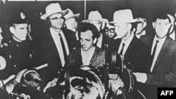 Lee Harvey Oswald appears at a press conference after his arrest in Dallas on November 22, 1963.
