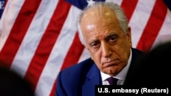 The U.S. special envoy for peace in Afghanistan, Zalmay Khalilzad, talks with local reporters at the U.S. Embassy in Kabul in November.