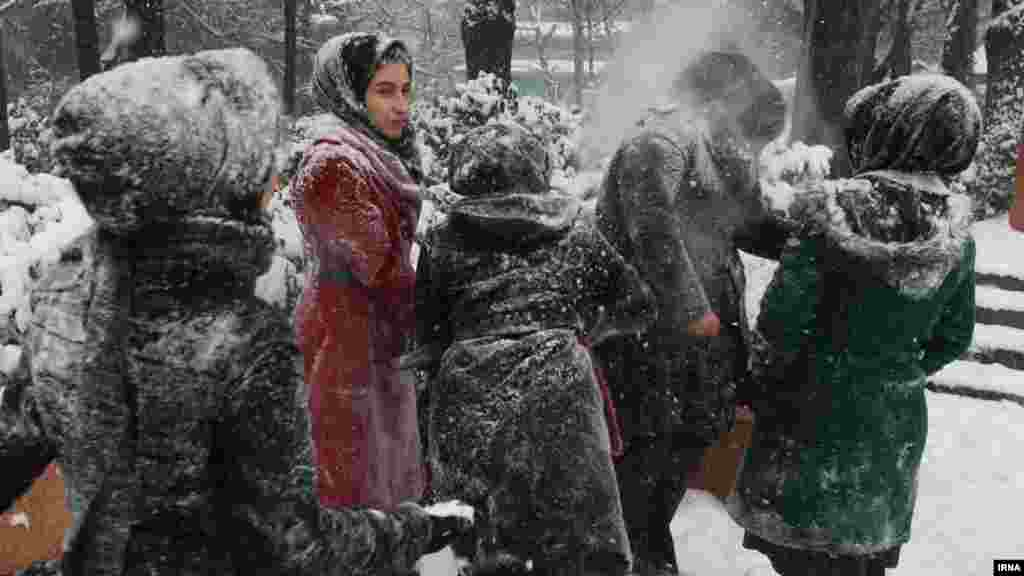 Young people play in the snow in a park in Iran's capital, Tehran.