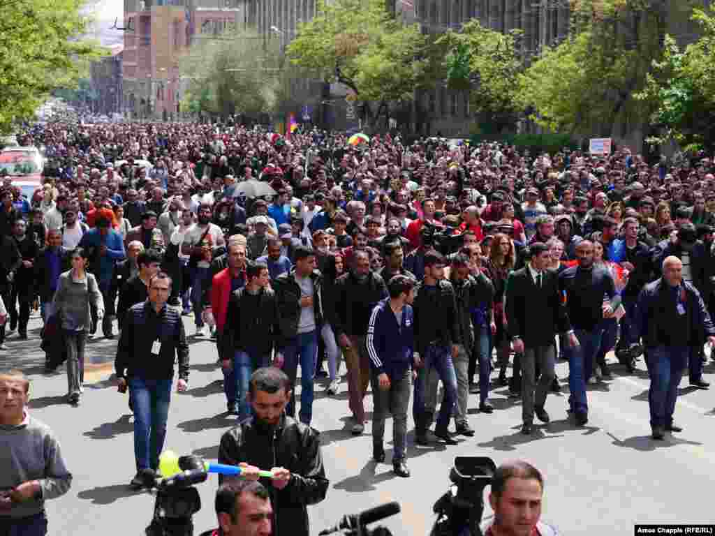 Now without a leader, protesters march back to the center of Yerevan.
