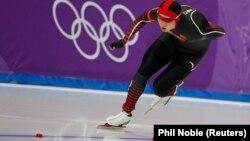 Этнический казах Аршынгазы Шакен, выступающий в составе сборной Китая по конькобежному спорту, на соревновании в Пхёнчхане. 13 февраля 2018 года.