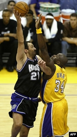 Divac (left) of the Sacramento Kings shoots against Shaquille O'Neal of the Los Angeles Lakers during Game 4 of the Western Conference Finals in Los Angeles in May 2002.