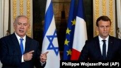 Бенямин Нетаняҳу ва Эммануэл Макрон соли 2017 дар шаҳри Париж.