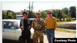 Bruce Pannier (right) poses with local soldiers in Batken in 1999.