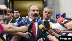 Armenia's new Prime Minister Nikol Pashinian speaks to reporters shortly after taking office in May 2018.