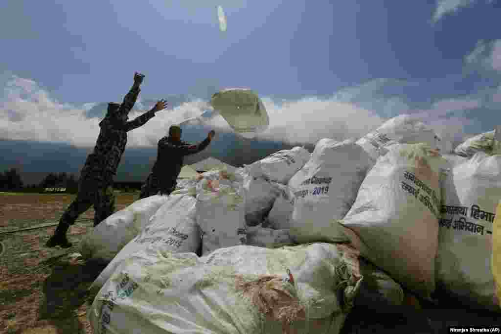 Nepalese soldiers pile up the garbage collected from Mount Everest in Namche Bajar on May 27. (AP/Niranjan Shrestha)