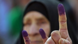 Ink-stained fingers after voting in Al-Najaf