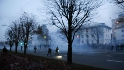 Riot police fired stun grenades at protesters as tens of thousands of people headed toward Independence Palace in Minsk on October 25.