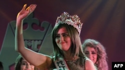 Shayma Qassim waves after winning the Miss Iraq beauty contest in Baghdad.