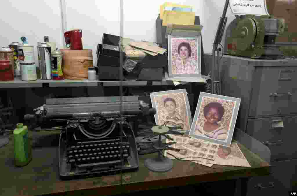 Typewriters and photographs that belonged to American diplomatic staff are on display.