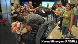 Armenia -- Syrian Armenians arrive at Yerevan airport, 17Aug2012.