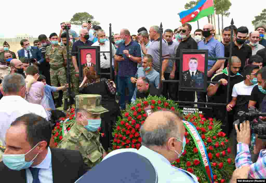 Mourners attend the funeral of Mirzayev and Azerbaijani Major General Polad Gashimov in Baku on July 15.