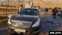 The aftermath of the attack that killed Iranian nuclear scientist Mohsen Fakhrizadeh near Tehran on November 27.