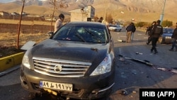 A photo made available by Iran state TV (IRIB) shows the damaged car of Iranian nuclear scientist Mohsen Fakhrizadeh after it was attacked near the capital Tehran, November 27, 2020.