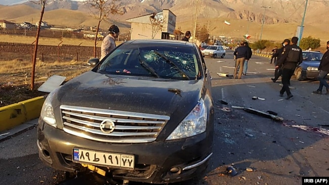 IRAN -- Aphoto made available by Iran state TV (IRIB) shows the damaged car of Iranian nuclear scientist Mohsen Fakhrizadeh after it was attacked near the capital Tehran, November 27, 2020