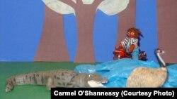 Иллюстрация из комикса о крокодиле, который О'Шоннесси показывала детям, чтобы добиться использования различных языковых форм