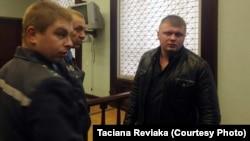Дзьмітры Лукашэвіч падчас суду ў кастрычніку 2014 году